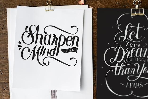 Letras de mão de citação de motivação em folhas de desenho Foto Premium