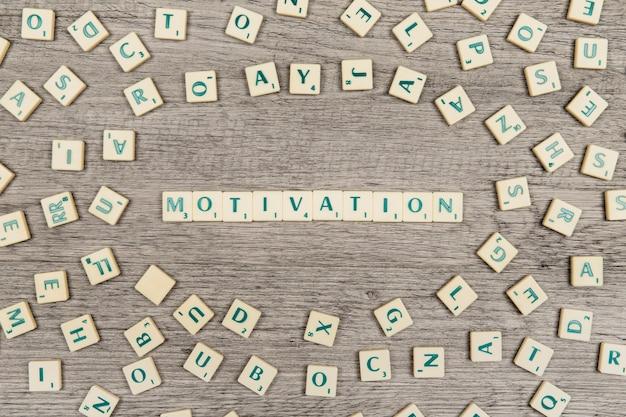 Letras formando a palavra motivação Foto gratuita