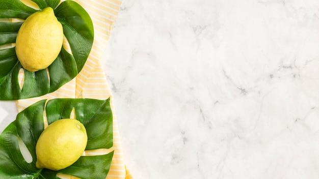Limões com fundo de espaço de cópia Foto gratuita