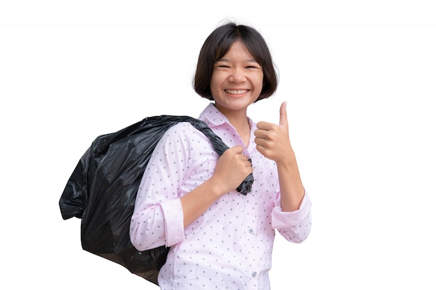 Linda garota asiática segurando o saco de lixo em branco Foto Premium