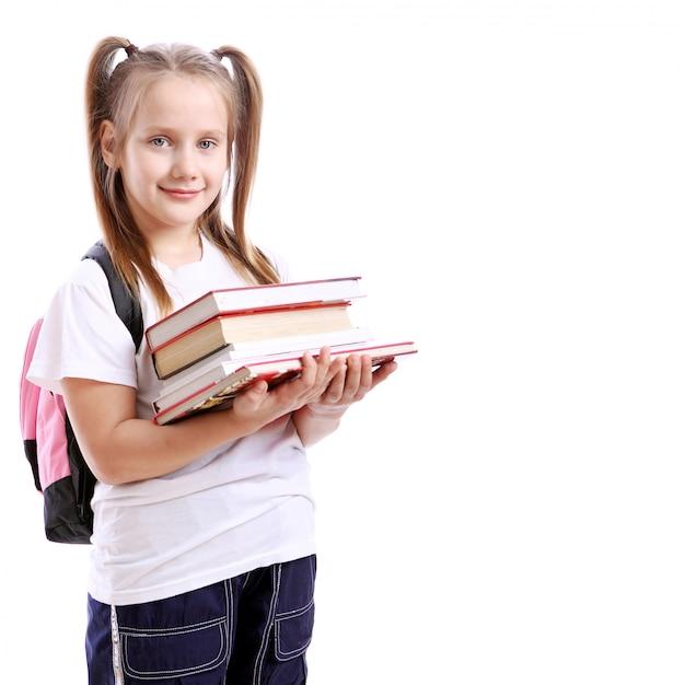 Linda garota com livros Foto gratuita