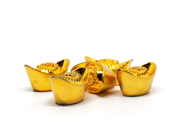 Lingote de ouro chinês sycee ou yuanbao barco Foto Premium