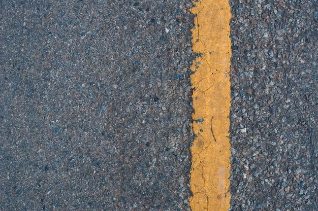 Linha amarela no fundo de textura de estrada Foto Premium