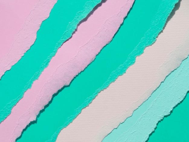 Linhas de papel abstrato rasgado oblíqua rosa e verde Foto gratuita