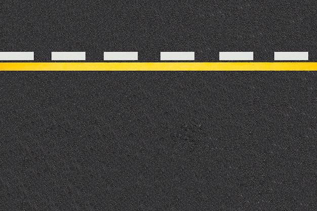 Linhas de tráfego no fundo de estradas pavimentadas Foto gratuita