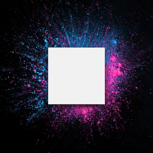 Livro branco com quadro de cores de holi. Foto gratuita