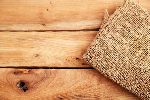Lona no plano de fundo texturizado de madeira. vista do topo Foto Premium