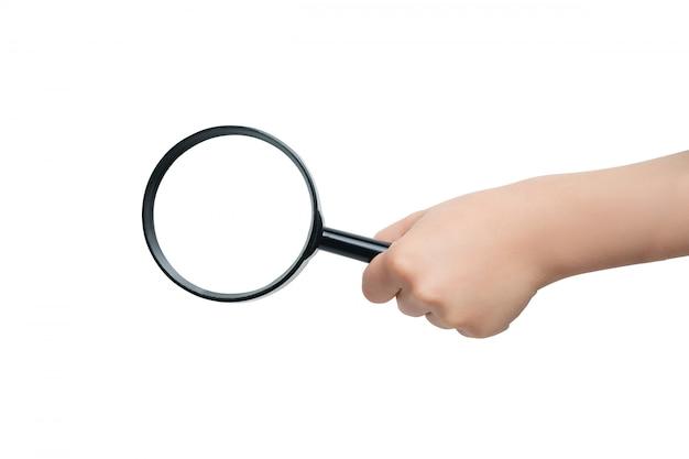 Lupa na mão de uma criança em um fundo branco. fechar-se Foto Premium