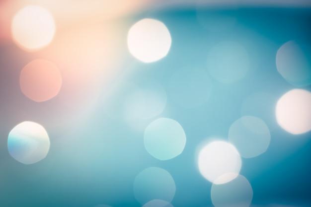 Luz abstrata azul turva bokeh para plano de fundo Foto Premium