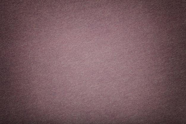 Luz - close up matte marrom da tela da camurça. textura de veludo de feltro. Foto Premium