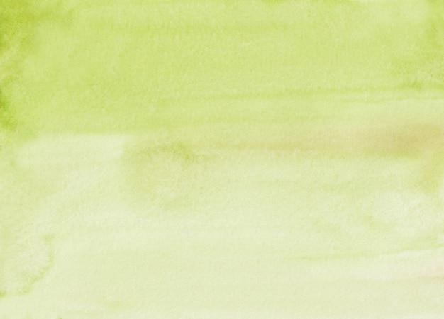 Luz da aquarela textura amarela do fundo da cor verde. sobreposição de cal de cor de água pintada à mão. manchas no papel. Foto Premium