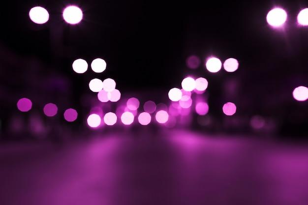 Luz de bokeh rosa na rua Foto Premium