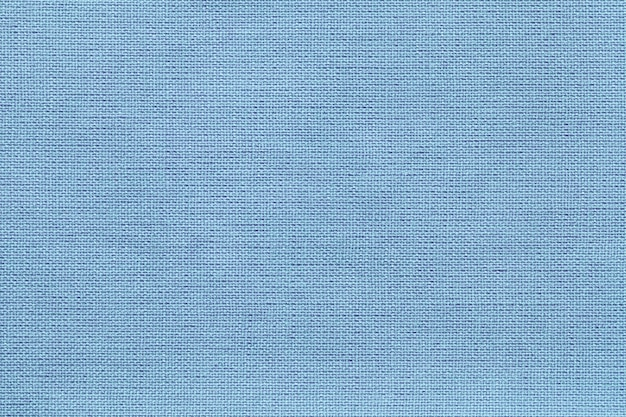 Luz - fundo azul de um material de matéria têxtil com teste padrão de vime, close up. Foto Premium
