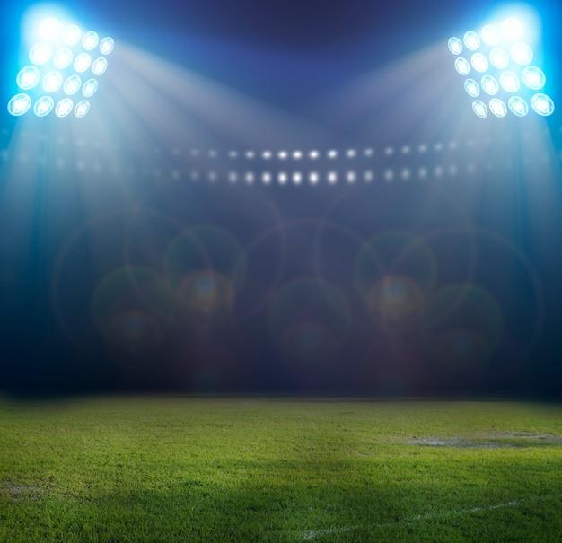Luzes à noite e estádio de futebol Foto Premium