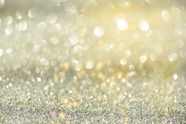 Luzes abstratas do bokeh do ouro e da prata. Foto Premium