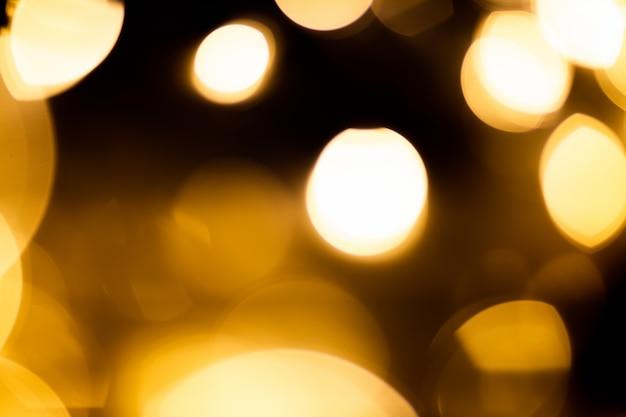 Luzes de bokeh em fundo preto Foto gratuita