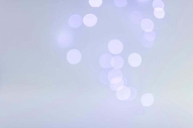 Luzes de bokeh no azul Foto gratuita