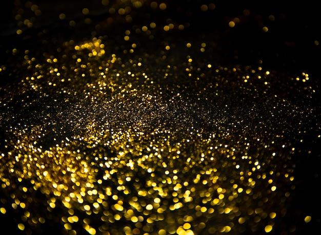 Luzes de brilho de ouro em preto Foto Premium