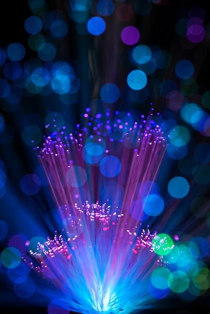 Luzes de fibra colorida com manchas desfocadas Foto gratuita