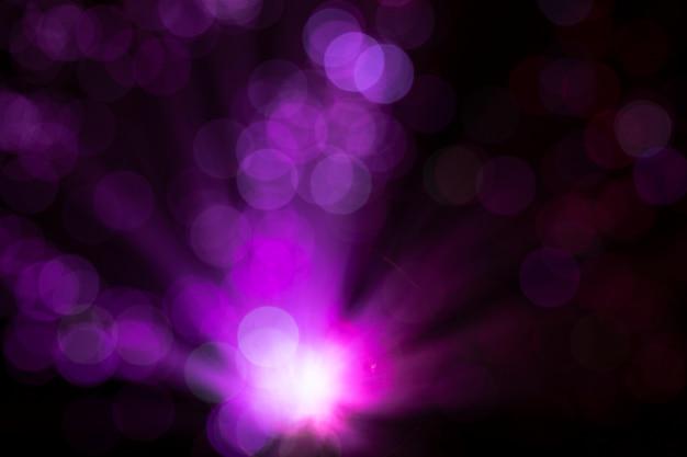 Luzes de fibra rosa com manchas desfocadas Foto gratuita