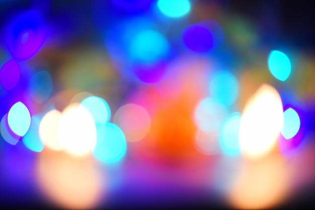 Luzes de natal luzes verdes e azuis bokeh abstrato multicolorido natal decorar ano novo Foto Premium