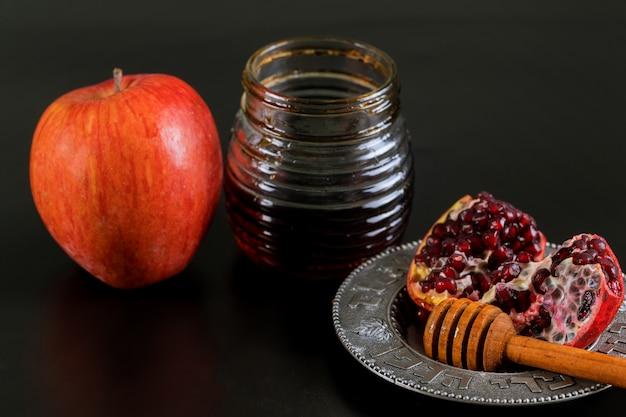 Maçãs, romã e mel para rosh hashaná Foto Premium