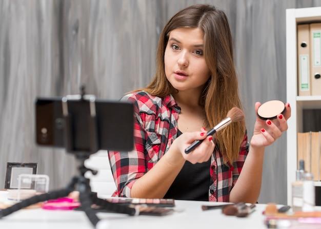 Make up vlogger Foto gratuita