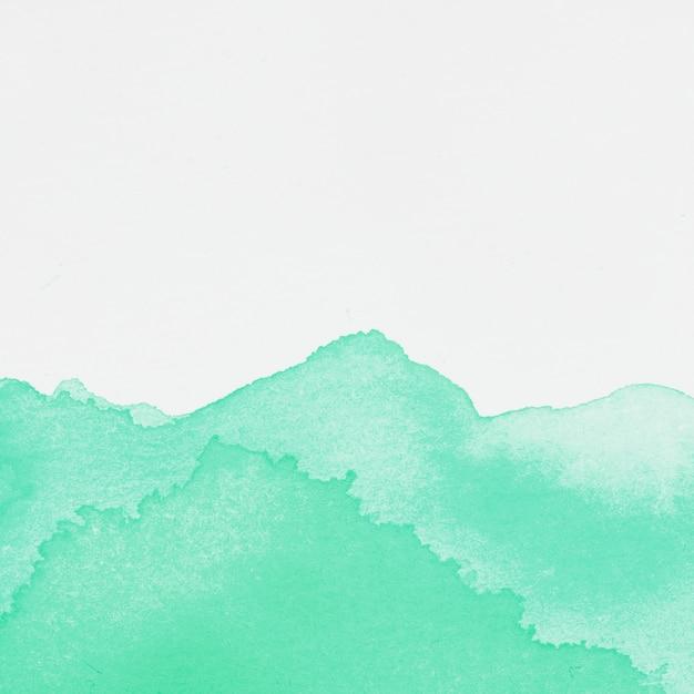Mancha de tinta esmeralda Foto gratuita
