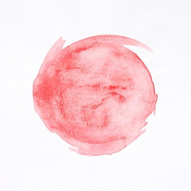 Mancha vermelha redonda fundo aquarela Foto gratuita