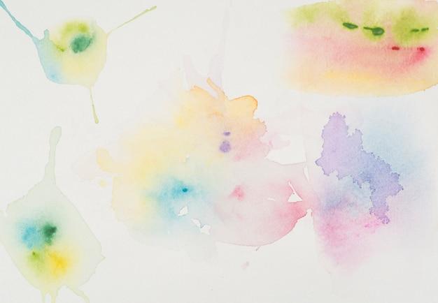 Manchas de aguarela brilhante Foto gratuita