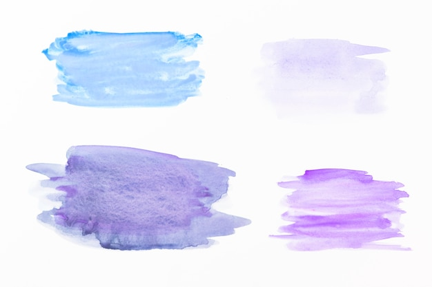 Manchas de aquarela azul e violeta Foto gratuita