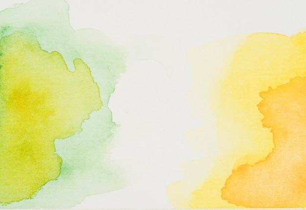 Manchas de aquarela verde e amarela Foto gratuita