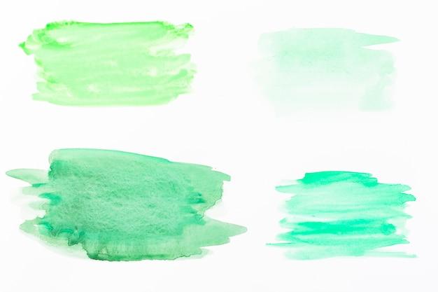 Manchas de aquarela verde Foto gratuita