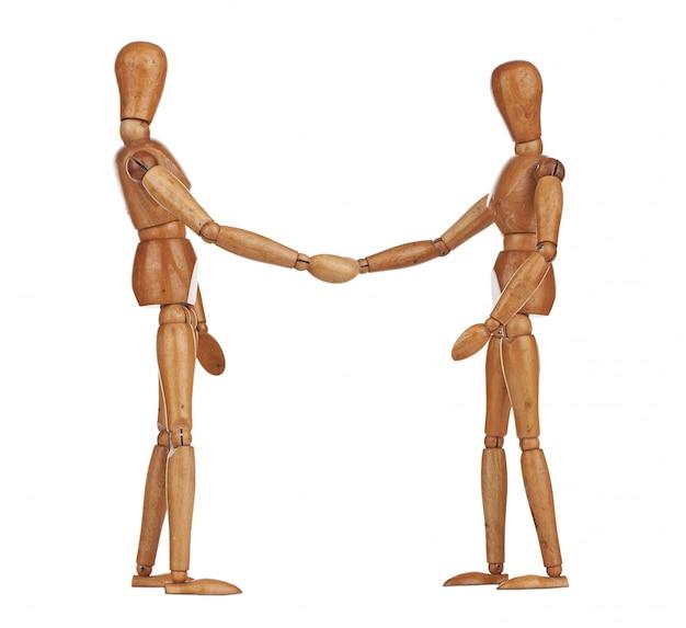 Manequins de madeira apertando as mãos, cooperação de negócios Foto Premium