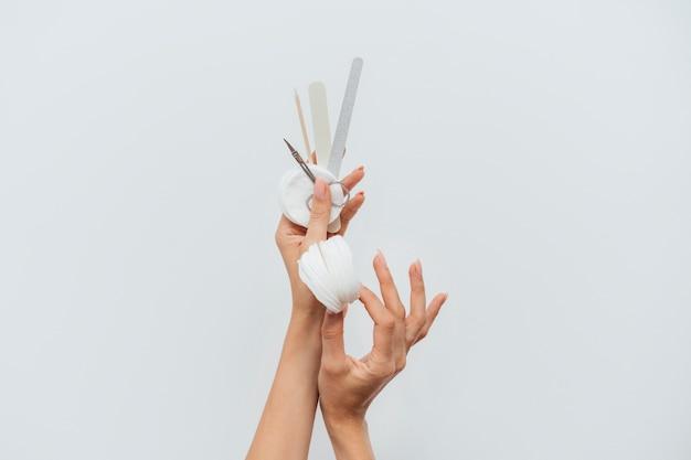 Manicure limas de cuidados saudáveis e almofadas de algodão Foto Premium