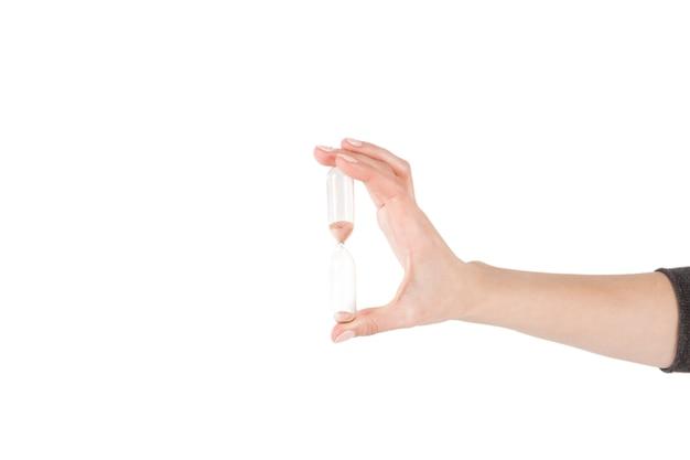Mão colheita, segurando, sandglass Foto gratuita