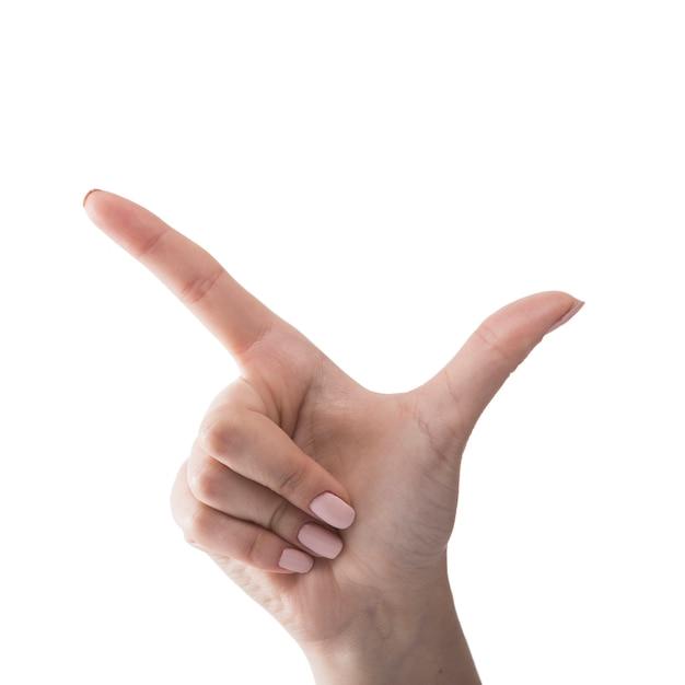 Mão de colheita mostrando o gesto de arma de mão Foto gratuita