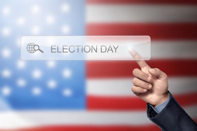 Mão de homem gosta de procurar um dia de eleição Foto Premium