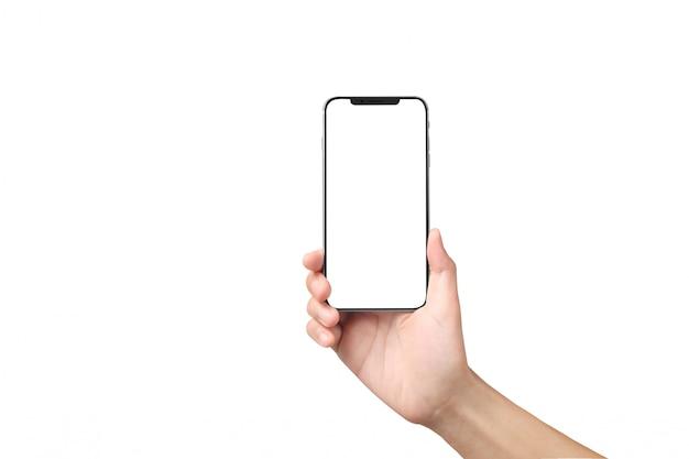 Mão de homem segurando o dispositivo smartphone e tela tocante Foto Premium