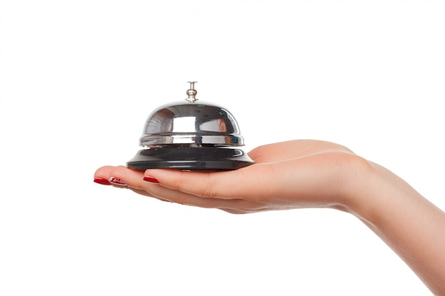 Mão, de, um, mulher, usando, um, hotel, sino, isolado Foto Premium