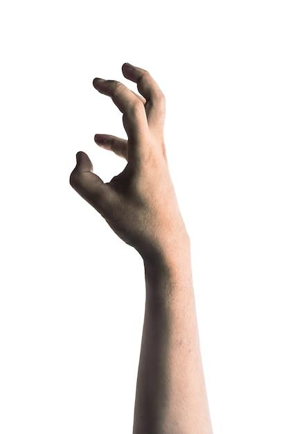Mão de zumbi assustador isolado no fundo branco Foto Premium