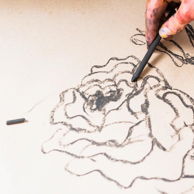 Mão desenho abstrato design com vara de carvão Foto gratuita