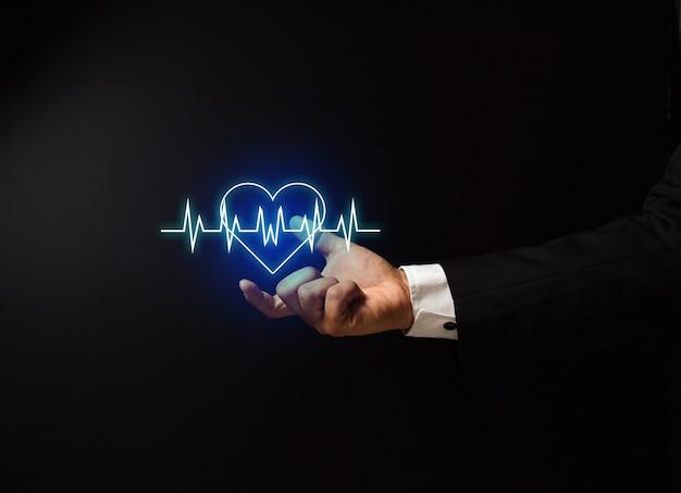 Mão do homem com design de conceito de saúde Foto Premium