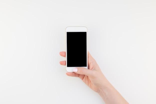 Mão mulher, com, smartphone Foto Premium