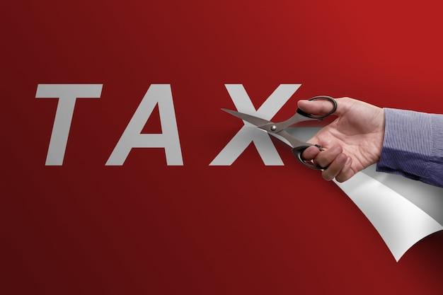 Mão negócio, com, tesouras, corte, imposto, palavra Foto Premium