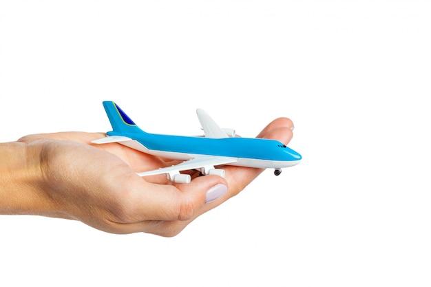 Mão, segurando, avião, brinquedo, modelo, isolado, branco Foto Premium