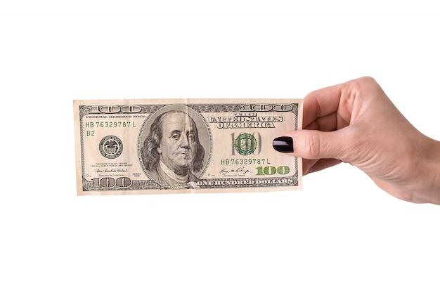 Mão segurando dinheiro dólares Foto Premium