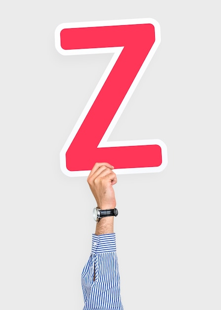 Mão segurando o sinal de letra z Foto gratuita
