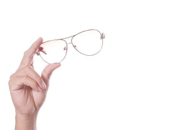 Mão segurando óculos vintage Foto Premium