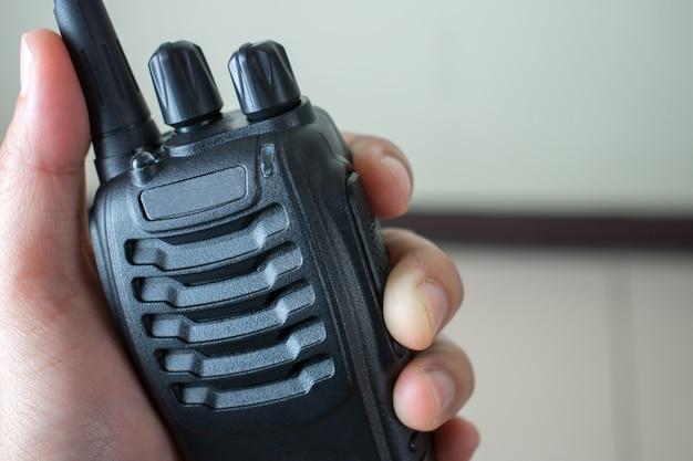 Mão, segurando, rádio, comunicação Foto Premium
